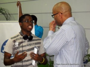 Student Clarence Cumberbatch (left) in conversation with Dr. Gayles after the lecture.