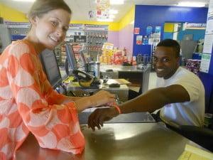 Kristen presents Harris' Sales Associate Jemar Small with a Team Kristen bracelet