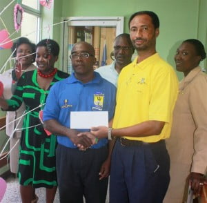 (left to right) Karaoke winner Clyde Springer receiving his prize of a dinner for two at the Hilton Hotel from  Allan Payne, Vice President of the BPI Sports Club and operator with the BPI.