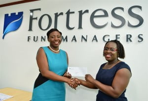 Ms. Kim Howard, marketing manager at Fortress Fund Managers (left) presents grand prize winner in the Fortress Fund Managers RRSP End of Year Promotion, Keisha Worrell with her voucher for $5000 in travel on American Airlines.