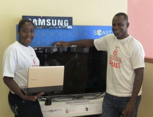Week 9 winner, Deborah Hunte (left), poses with her new Samsung Laptop, while week 10 winner Roger Thompson poses with his Samsung TV.