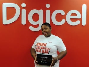 Shavon Als, the week 8 winner in Digicel's Win a Piece of Paradise and Smile promotion, poses with her brand new Samsung Galaxy Tablet.