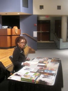 HNP president Jacqueline Sample exhibiting the Caribbean publisher's books at a Hudson Valley Community College literary reading, New York. (HNP file photo)