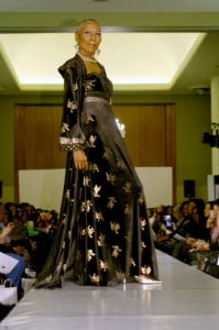 Pieces of decadent fabrics are adored with mythical creatures to symbolize 2013 as the year of the serpent. The fashion looks were cut using ready-to-wear dresses, yet finished with haute couture techniques.