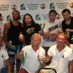 A group of Swedish pose with members of St. Maarten's Reggae Rock fusion band Orange Grove which performed at one of the Regatta parties