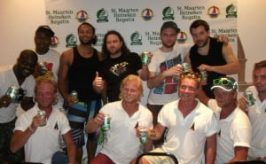 A group of Swedish pose with members of St. Maarten's Reggae-Rock fusion band Orange Grove which performed at one of the Regatta parties