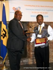 Guyana's Honorary Consul General Michael Brotherson (Left) receives tribute from CaFA's creator& Curator Anderson M. Pilgrim