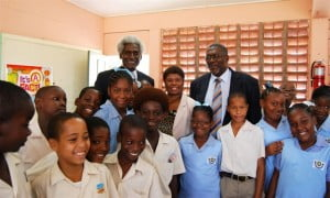 U.S. Ambassador Larry Palmer, NCSA manager Yolande Forde and Senator Harry Husbands, Parliamentary Secretary in the Ministry of Education, Science, Technology and Innovation, with Class 3 students of the Luther Thorne Memorial Primary School after the It's A Fact video launch and screening.