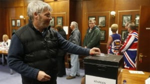 {IMAGE VIA - nzz.ch} Gavin Short (at ballot box) was born in 1962 in Stanley, Falkland Islands.  He was educated locally and then went on to undertake a BTEC in Telecommunications.  Gavin is currently employed by Cable & Wireless but previously worked for the Falkland Islands Company and the Falkland Islands Government.  He is also the Chairman of the General Employees' Union. He is MLA for Stanley Constituency.