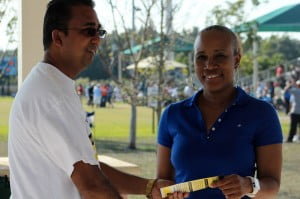Raymond Brown congratulates Karen Chung from the Immaculate Conception High School Alumnae Association, the winner of the the Grace Kennedy Remittance Services/ Western Union All Girls Schools Alumni Penalty Kick-off.