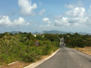 {IMAGE VIA - asthecrowefliesandreads.blospot.com} Section of Jeremiah Gumbs Highway, Anguilla
