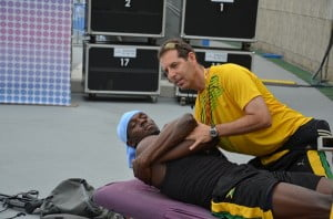 Dr. Douglas working with Usain Bolt before a race.