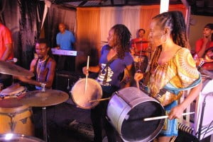 """(L to R - James De Lovell, Juanita Clarke, Dj Hurricane) After a brief break, the second half was all about the man of the night James De Lovell and his young band The Performance. A dynamic presence for such a small man, De Lovell spoke in clear tones boldly announcing every so often that """"…we is Bajans! We could do anyt'ing we want!..."""" and telling patrons to """"…keep it straight!""""."""