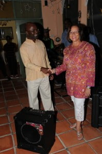 Barbados Jazz Society presents a bass amplifier to the Music Program at Barbados Community College