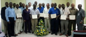 Representatives from the BPI, SAB, BWU and CMI standing with Graduates of the Stevedore Level III Training Programme