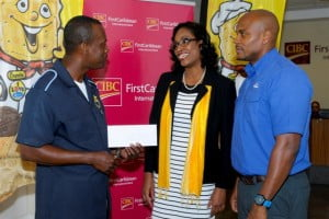 Darville Sealy (left), who collected the grand prize in the WIBISCO 30 Days of Giveaways promotion on behalf of friend, Jackie Clarke, shares in the happy moment with CIBC FirstCaribbean District Manager (Retail) Barbados, Stephane Burke; and WIBISCO Brand Manager, Troy Best.