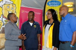 Executive Director of Variety, Donnah Russell (left) shares plans for the $2,500.00 CIBC FirstCaribbean bank account the charity received through the WIBISCO 30 Days of Giveaways promotion with Darville Sealy; CIBC FirstCaribbean District Manager (Retail) Barbados, Stephane Burke; and WIBISCO Brand Manager, Troy Best.