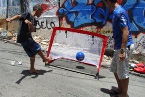 Victor Hugo Poria Nasicmento (10 years) scores the first goal out of 1,000,000 for an AIDS-free generation in the Historic Centre (known in Portuguese as The Pelourinho). The score a goal for an AIDS-free generation project will conclude during the 2014 World Cup in Brazil.