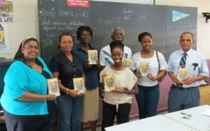 L-R: Tallulah Vanterpool-Baly, head, Students Care, St. Maarten Academy; Kim Luscas-Felix, head, English Department, St. Maarten Academy; Ivonne John, teacher; Rochelle Ward (Faizah Tabasamu), teacher, English literature and language; Max Rippon, poet, novelist; Akilah Meulens, member, BFC; and Shareed Hussain, principal, St. Maarten Academy. (CLF photo)