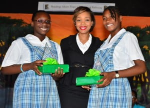 Arkayla Clarke (left) and Markayla Smith-Rock, joint winners of the Best Reader Award in Springer Memorial's 2013 Reading Programme are congratulated by Gina Cummins, Group Marketing & Communications Coordinator with SOL (CARIBBEAN) LTD.