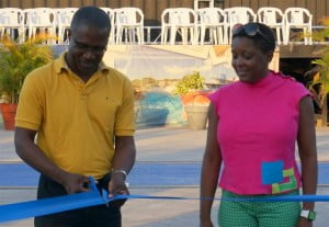 David Jean-Marie, Chief Executive Officer, BPI, cutting the ribbon to officially unveil the road tennis courts alongside Michele Griffith, Assistant Manager, Management Information Systems, BPI