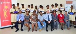 The graduating class at Christ Church Foundation School show off their certificates along with (seated in the front row left to right) Principal Robert Cumberbatch; Deputy Principal Yvette Mayers; JA Lead Teacher, Danielle Doughlin; Volunteer Business Owner, Bradley Greaves; Guest Speaker, Mac Anderson, Scotiabank's AGM and Head of Corporate & Commercial Banking Centre; Scotiabank JA Mentor Donna Parris;  Scotiabank JA Mentor Lisa Harewood and JA Program Officer Maryam Pandor