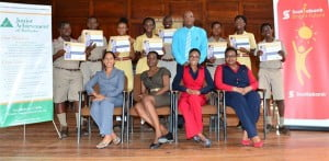 The Harrison College graduating class celebrate their achievement with Principal Winston Crichlow (standing fourth from right) and the program's facilitators (seated in the front row from left to right) JA Program Officer Maryam Pandor; JA Lead Teacher Ms. Kristle Springer; Scotiabank JA Mentor Keisha Payne and Scotiabank JA Mentor Keisha Straughn.