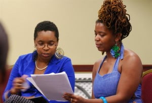 """A workshop participant and Katori Hall read lines from her new play """"Blood Quilt""""."""