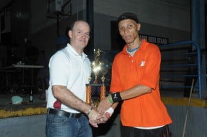 Winner of the inaugural ANSA McAL (Barbados) Ltd. Road Tennis Competition, Nolan Stuart of Trimart Supermarkets (right), receives his trophy from CEO of Bryden Stokes Ltd., Andrew Lewis.