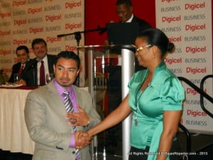 This lucky lady from the Urban Development Commission won a yet to be released in Barbados, Blackberry Z10 mobile from Territory Manager, Josh Zelaya