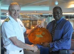 From left: Captain Karlo Buer, Seabourn Sojourn, accepting a commemorative plaque from Kenneth Atherley, Divisional Manager, Corporate Development and Strategy, BPI.