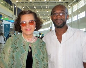 Ambassador Chiqui Vicioso, leading author from the Dominican Rep., in-transit at SXM with St. Martin Book Fair coordinator Shujah Reiph  (CLF photo)