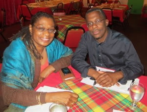 Marion Bethel (R), filmmaker and award-winning Bahamian author, in-transit through St. Martin from the Caribbean Writers Congress, Guadeloupe, at Yvette's Restaurant discussing St. Martin Book Fair 2013, with her publisher Lasana M. Sekou (CLF photo)