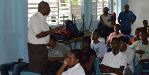 Franklyn Greenaway of the Montserrat Development Corporation speaks to third form students at the Montserrat Secondary School at the Entrepreneur's Forum about plans for the new town and how they fit it, on Thursday, May 9, 2013. (Linda Dias Photo)