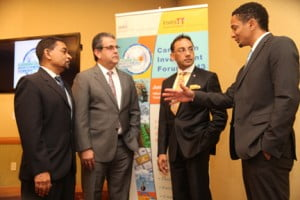 Trinidad & Tobago's Trade, Industry & Investment Minister, Vasant Bharath, second from right, chats with (l to r): President of InvesTT , Kelvin Mahabir,; TIC Chairman, Anthony Aboud, and Managing Director Full Circle Animation, Jason Lindsay, during the formal launch of the Caribbean Investment Forum held at the Hyatt Hotel on May 14, 2013 in Port-of-Spain, Trinidad.  (PHOTO: SHIRLEY BAHADUR)