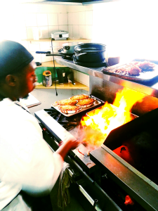 Can't take the heat? Not Carl.....that's why he's always in the kitchen! ;) Meet Mojo's Kitchen Supervisor - Carl Daniel
