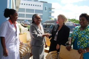 (Left to right Dr. Chaynie Williams and is Senior Sister, Margarette Wilson accept the 34 new chairs for the Accident and Emergency Department of the Queen Elizabeth Hospital in Barbados presented by Ms. Holly Peirce and Nurse Mary Thompson of the U.S. Embassy.