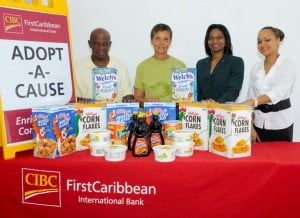 Tony Bourne (left) and Lynn Tempro (second left) of the Christ the King Breakfast Feeding Programme gladly accept the donation of breakfast items from Rosslyn Alleyne (third left) and Ayesha Lett (right) of the Corporate and Internal Communications department of CIBC FirstCaribbean