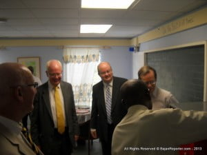 Principal Mr Straughn carries Lord Wallace on a tour of the classrooms at Irving Wislon