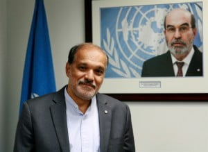 FAO Subregional Coordinator for the Caribbean, Dr. J.R.Deep Ford stands beneath a portrait of FAO Director-General, Dr. Jose Graziano da Silva