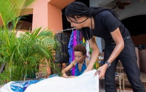 Kaj's executive team, CEO/Director, Liza Miller, and President/Creative Director, Ayoung-Julien, prepare the Kaj space at the trunk show during the 2012 Ocean Style FashionShowcase in      Montego Bay, Jamaica. Photo courtesy Mark Gellineau.