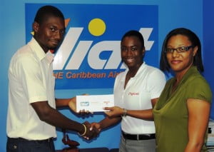 Romelle Small (left) collecting his prize from Senior Marketing Executive with Digicel, Krystle Smith (centre) and Leia Walker, Marketing Associate with LIAT.