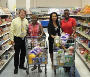 Jessica Mason (second from left) beginning her shopping at Trimart Haggatt Hall, accompanied by Geoffrey Evelyn (left), CEO of Trimart Supermarket, Krystle Smith (right), Senior Marketing Executive with Digicel and Rosemary Campbell, Trimart Store Manager.