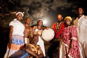 Clara Reyes (2nd R), author of upcoming Ponum history book, following videography of a Ponum rehearsal at night near the Bellevue Frontier Monument, L-R: dancers Dashaun Prince, Clifford Henry; Hellier Coquillas (master drummer), Claudine Dessert (shak-shak), Albert Pierre (Boula drum); and dancer Rudolph Davis. (HNP photo)