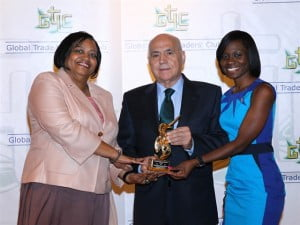 SXM Airport Managing Director Regina LaBega (L) and Corporate Communication Specialist Kalifa Hickinson (R), pose with Secretary General and CEO of GTLC, Ricardo Roso Lopez, after receiving the International Transport Award. (Photo courtesy SXM)