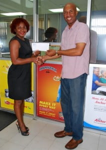 2.Paula Wilkinson, Marketing Coordinator presents the cheque for sponsorship of the Big Show to Red Plastic Bag.