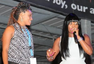 Dancehall icon Lady Saw shares a fun onstage moment with a local attendee