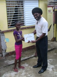 "Shanai Henry - ""Wish Child"" receiving her prize from ezLearner CEO, Troy Weekes."