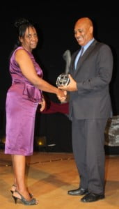 Mrs Vernetta Williams receives the National Teacher of the Year award from Hon. Minister of Education Colin Riley at the Annual Teacher and Student Awards.