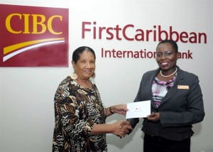 Managing Director of the Arnott Cato Foundation, Margaret Hope received funds to go towards the hosting an annual medical conference in St Vincent and the Grenadines from CIBC FirstCaribbean International Bank, here represented by Barbados Retail Banking Director, Michelle Whitelaw.